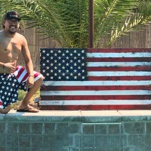 rolando corral with united states wooden flag