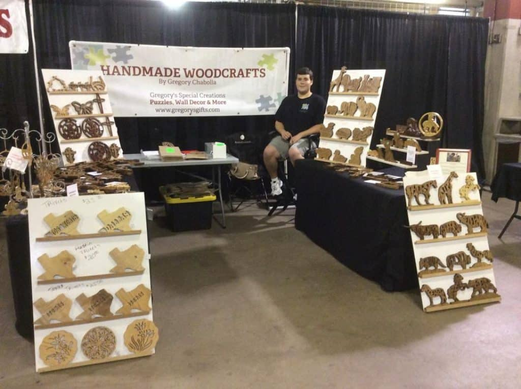 Gregory in his handmade woodcrafts sale