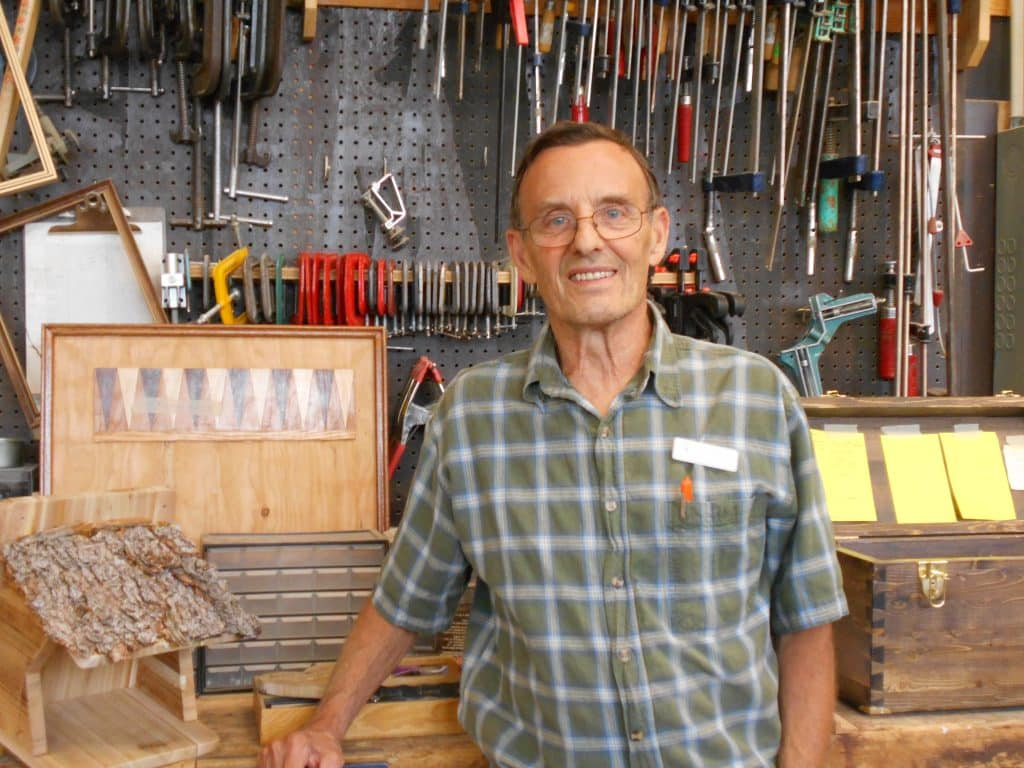 Volunteer John Gangon on the shop