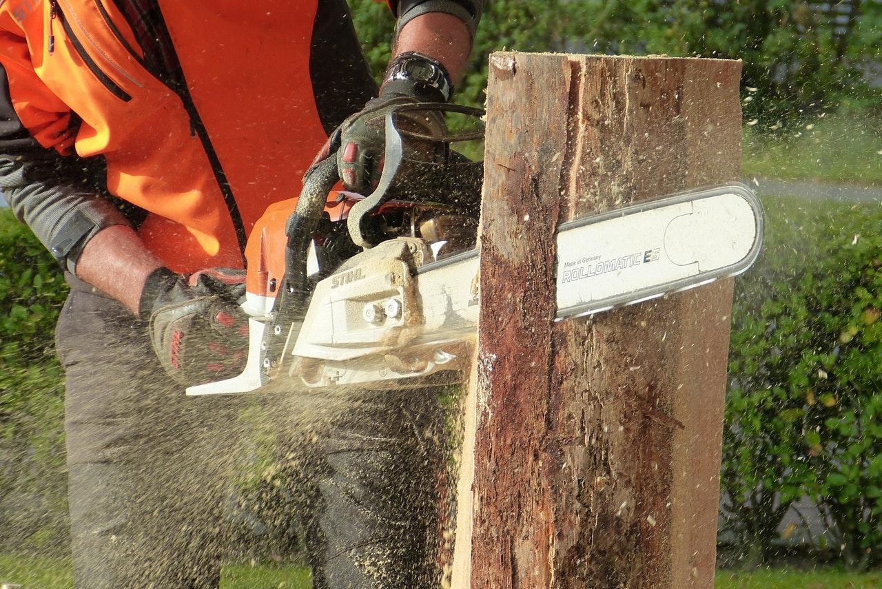 chainsaw cutting through wood