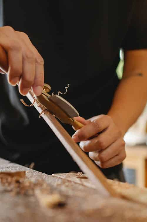 woodworker using a spokeshave