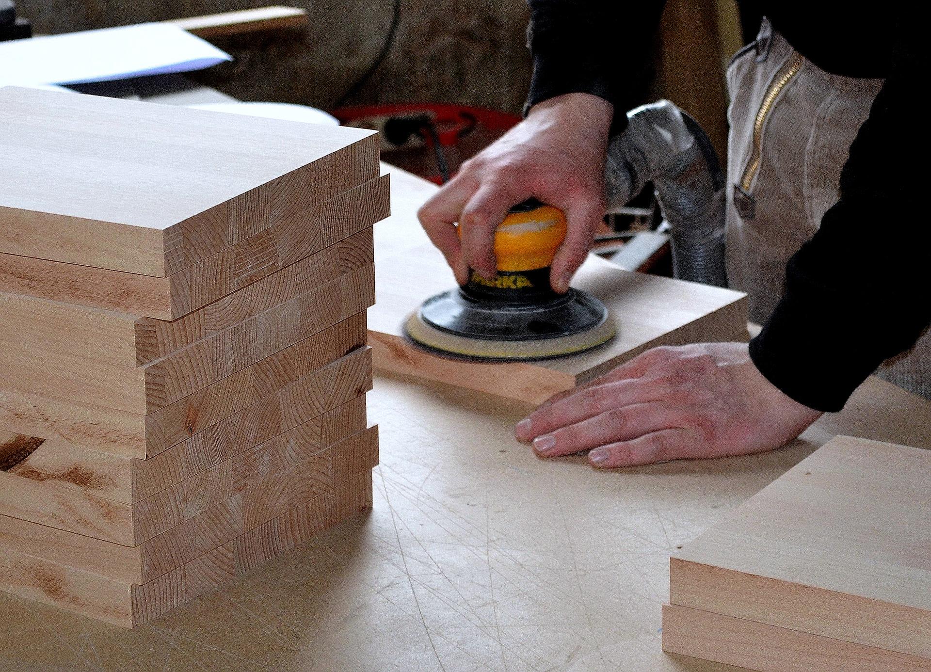 carpenter polishing wood slab