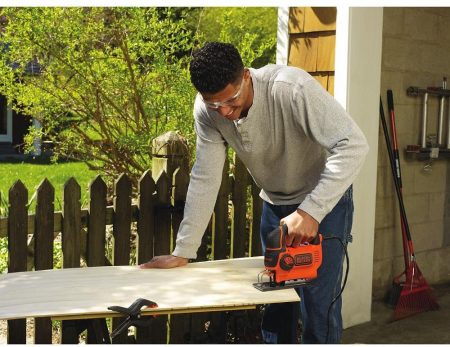 Man operating the BLACK+DECKER Jig Saw, Smart Select, 5.0-Amp (BDEJS600C) - in action