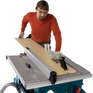 man operating a Bosch 4100 table saw