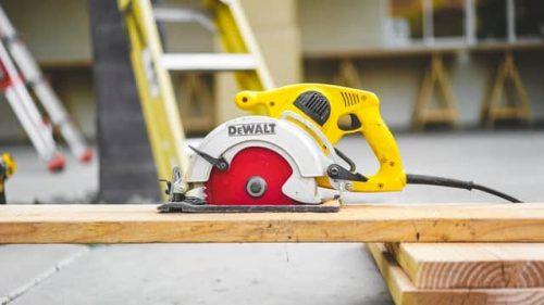 a Dewalt power tool on top of a plywood