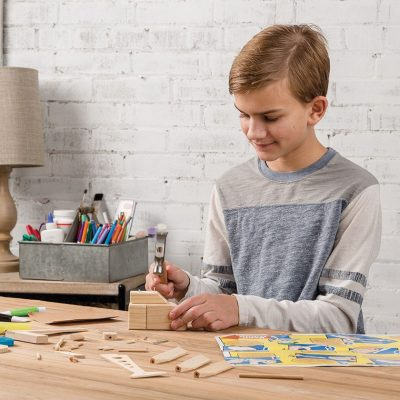 a kid building a toy
