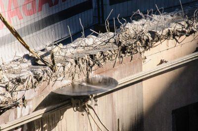 circular saw cutting powerfully through concrete