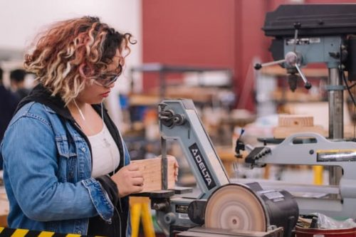 woman in woodworking class