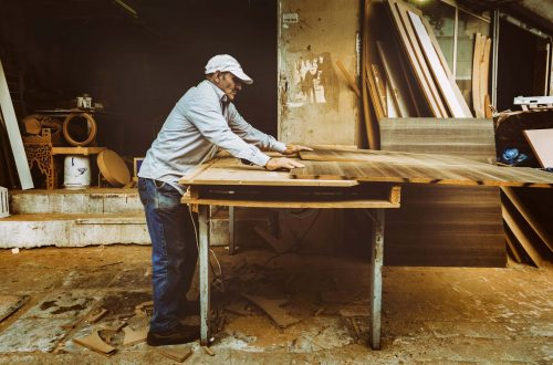 man operating a table saw