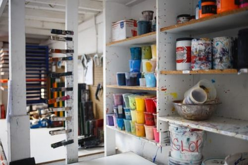paint and other stuff stored on shelves