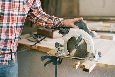 man operating a circular saw
