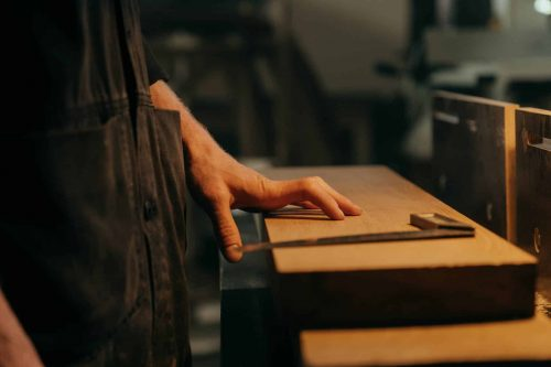 hand on thick wooden board