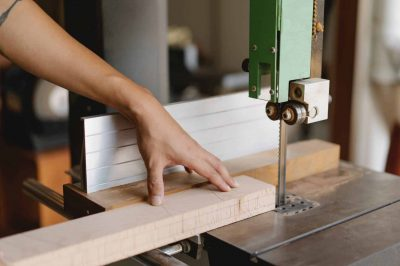 wood worker using a bandsaw